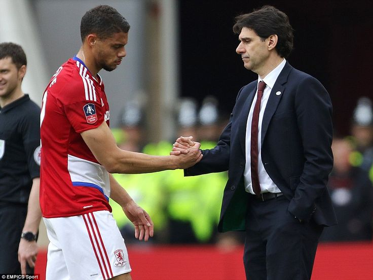 Aitor Karanka (right), manager of Middlesbrough, shakes hands with Rudy Gestede after he is forced off through injury