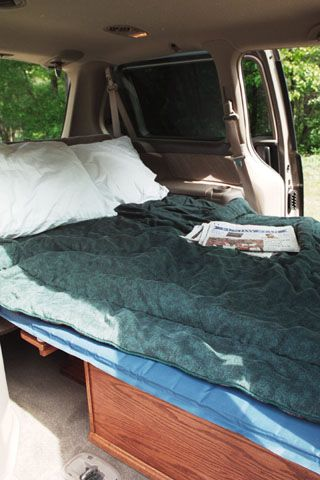 Honda Odyssey Camping - Sleeping in your van while travelling may not appeal to everyone but when on an extended vacation with a lot of one night stands and unexpected rain on occasion, it certainly is an alternative for some. So for those few who might be interested, here is my solution.... The challenge was to build something that would allow us to sleep in the van, provide a table to eat at if necessary and give us some accessible storage as well.