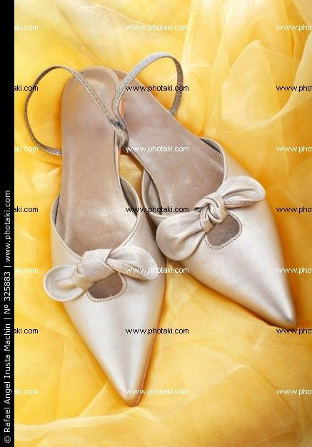 http://www.photaki.com/picture-wedding-shoes-on-a-yellow-background-with-soft-shadow_325883.htm