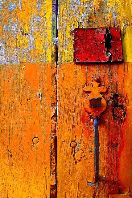 Love this old fashioned lock & key and the gritty, rough door. Also, the unintentional mix of colors via the faded paint is exquisite.