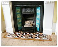 Restored fireplace with tiles at the hearth as well as the sides would add more texture to the room.