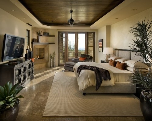 If your master bedroom is fortunate enough to have a tray ceiling, place leftover wood flooring inside of the tray to take the eye upward for an instant wow factor.