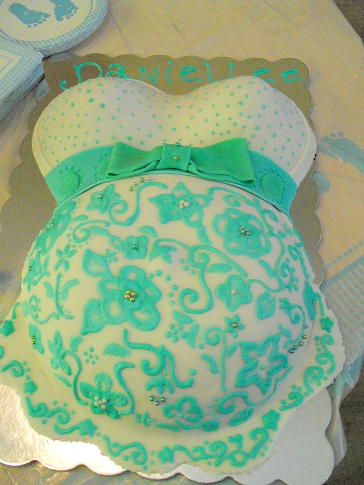 My first baby bump cake a friend requested for her baby shower today. It took about 10 hours from mixing bowl to finish (because one of the boobs wouldn't bake -___-), but I'm pretty happy with how it turned out. :)