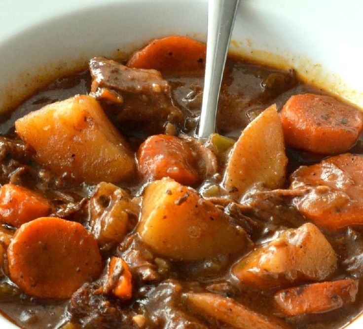 Pan seared beef, fresh carrots, onions, celery, potatoes and mushrooms simmer in the crockpot while swimming in a bath of lovely bold red wine, Guinness and beef broth until the gravy is nice and thick and the beef is fall off the fork tender!  My one AND ONLY Beef Stew recipe.