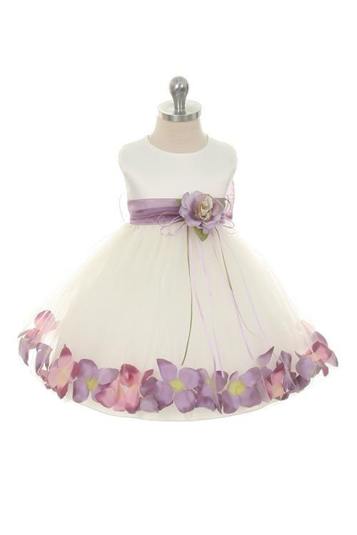 Klein bruidsmeisjes jurkje Silvina. Leuk en apart jurkje! Het lijfje is van satijn en heeft een tule rok. In de rok zijn losse blaadjes verwerkt die vrolijk in de tule-rok 'rond dansen'. De blaadjes zijn in diverse kleuren verkrijgbaar.