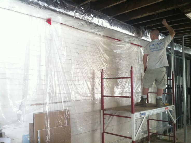 These are our techniques to keeping exposed brick clean during a spray foam application #sprayfoam #insulation #foamit