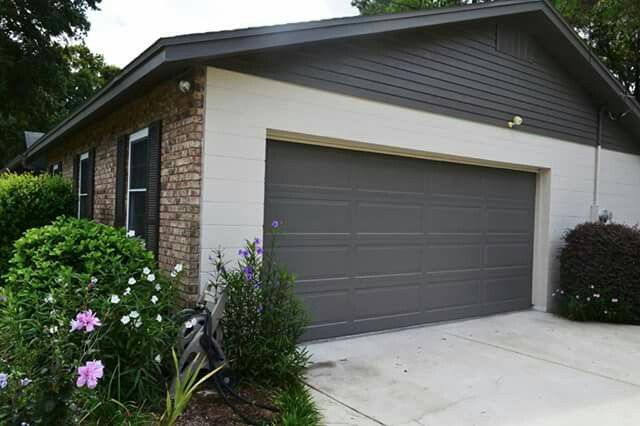 AFTER: Garage door, soffit, gutter, trim, and most gables are SW Gauntlet Gray, concrete block is SW Accessible Beige, Shutters are SW Black Fox (a brownish gray).