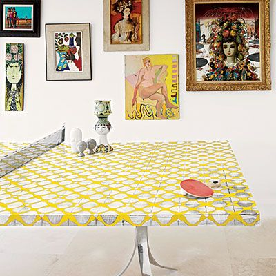 "Different shapes, sizes, colors, but ""They're all paintings and sculptures of women staring back at you."" LOVE that. And I love the ping pong table instead of a traditional dining room table. -Jonathan Adler"