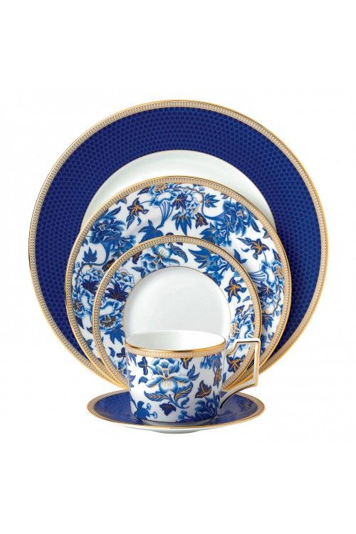 Hibiscus - Inspired by a Wedgwood archive pattern dating back to around 1810, Hibiscus is a sophisticated collection with timeless classic elements and real gold highlights. This stylish pattern features a striking design of oriental blue hues and lavish botanical all skillfully hand-lined in 22-carat gold for an elegant and opulent finish.