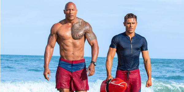 What It's Like To Work With The Rock, According To Zac Efron