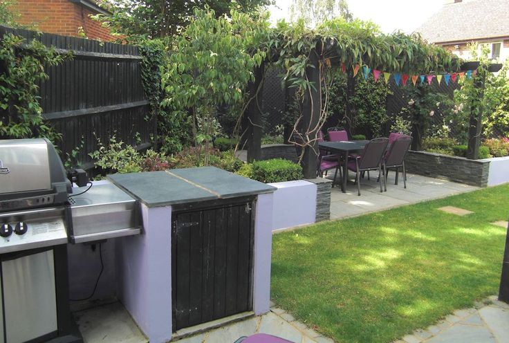 Contemporary garden design, Bracknell, Berkshire with outdoor rooms for eating, sitting and enjoying the sun at different times of the day.  A small outdoor kitchen, raised borders with rendered blockwork retaining walls, a pergola and a lawn area.  Designed by Linsey Evans Garden Design