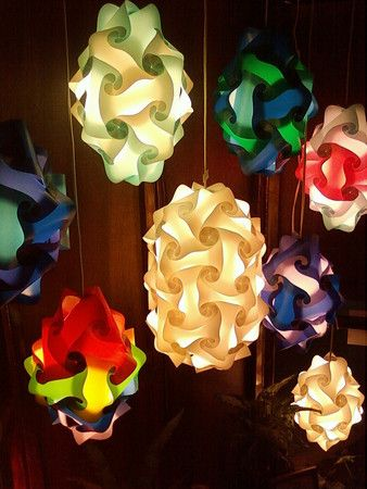 Puzzle Lights are our newest style of lighting for events. These lanterns/lights are made out of 100% recycled plastic. They are called puzzle lights because every light is made out of individual plastic pieces that have been pieced together. They come in all shapes and sizes, from circles and ovals to hearts and stars. A very unique and eye catching light that will be sure to leave an impression on your guests