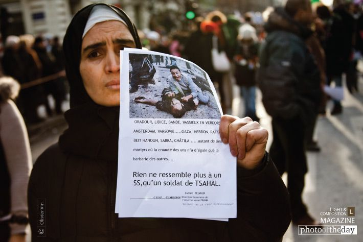 """Sorrow and Pain, by Olivier Vin - Demonstration against violence in Gaza, during Israel's Operation Cast Lead, over 30,000 people marched through Brussels as a peaceful protest. This lady handed a flyer where it is written: """"Oradour, Lidice, Bande, Vassieux-en-Vercors, ...."""