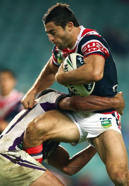 Anthony Minichiello of the Roosters is tackled during the round 11 NRL match between the Sydney Roosters and the Melbourne Storm at Allianz Stadium on May 25, 2013 in Sydney, Australia. http://footyboys.com