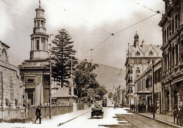 Wale Street, Cape Town. An early view of Wale Street showing, at left, St. George's Cathedral. The bell tower, which is prominent in this photograph, was demolished in 1952 after it became unsafe. The first building on the right is now the Taj Hotel while the building in the middle distance at right is the present day Mandela-Rhodes building. Part of Signal Hill can be seen in the background. | Flickr - Photo Sharing!