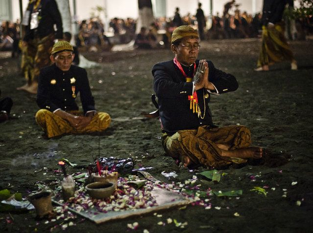 "Javanese people pray before rituals night carnival ""1st Suro"" (Javanese calender) during Islamic New Year celebrations at Kasunanan Palace on November 14, 2012 in Solo City, Central Java, Indonesia."