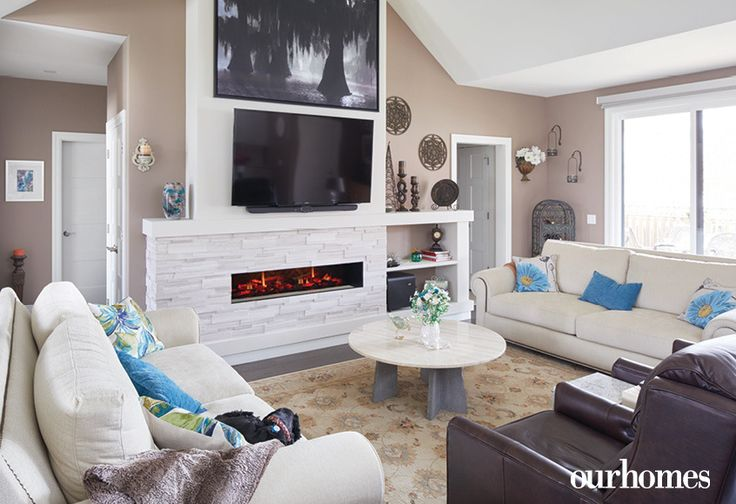 """Vaulted ceilings and abundant light from the wall-to-wall rear porch windows create the illusion of more space in this compact open-concept living area.    See more of this home in """"She Loved this Chandelier and Built a House to Suit It"""" from OUR HOMES Wellington County Orangeville Caledon, Summer 2017: http://www.ourhomes.ca/articles/build/article/she-loved-this-chandelier-and-built-a-house-to-suit-it"""