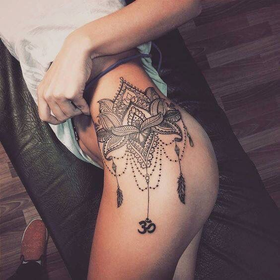 mandala style tattoo on thigh/hip