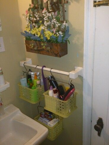 I have a very small bathroom and neededmore storage space. I used three storage bins with handles and S hooks to conect them and hung them from the towle rack that never get used.