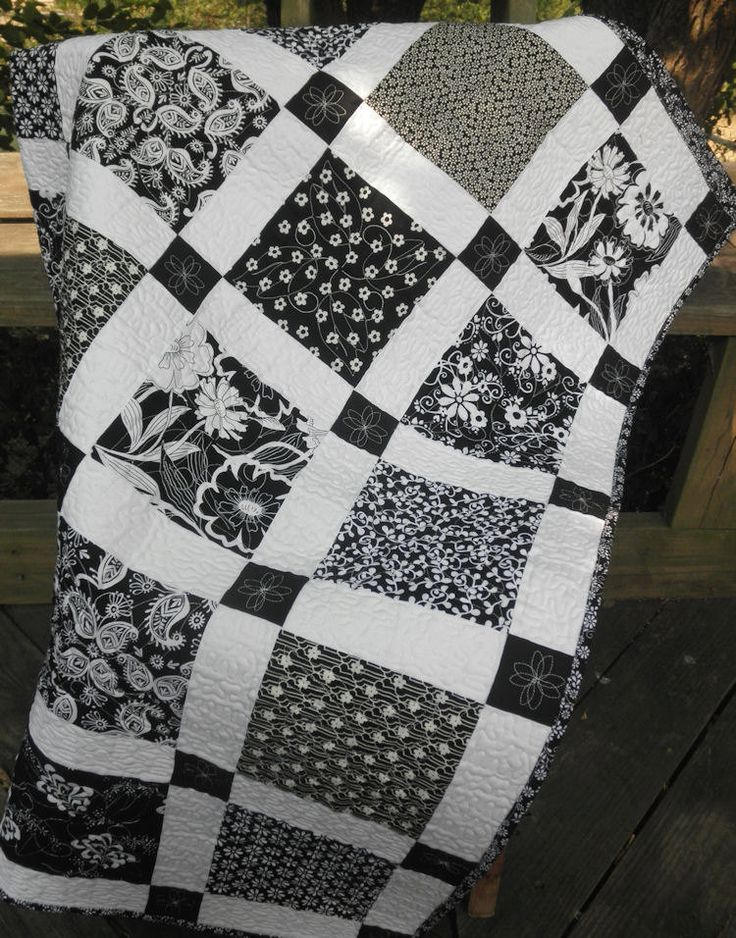 ~Black and White Shabby Chic. This could be achieved with a Disappearing 9 patch using the solid black as the center square and the white as the 4 alternating squares~
