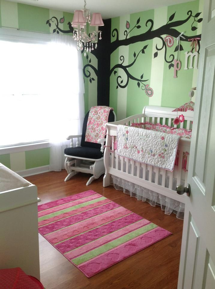 For Paisley's nursery, we wanted to go with a sweet, whimsical theme.  I love pink, but I didn't want to be overwhelming with it, so we chose soft shades of green and contrasted with pinks.  Our friend (and Paisley's Godfather) custom painted the mural on the wall.