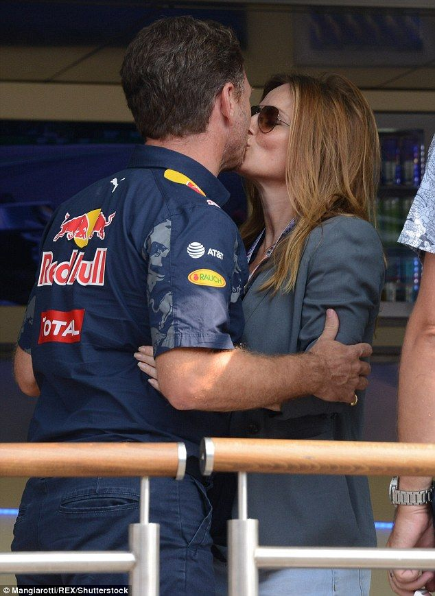 Sealed with a kiss: Geri Halliwell enjoyed an intimate moment with husband Christian Horner at the Italian Grand Prix in Monza on Saturday