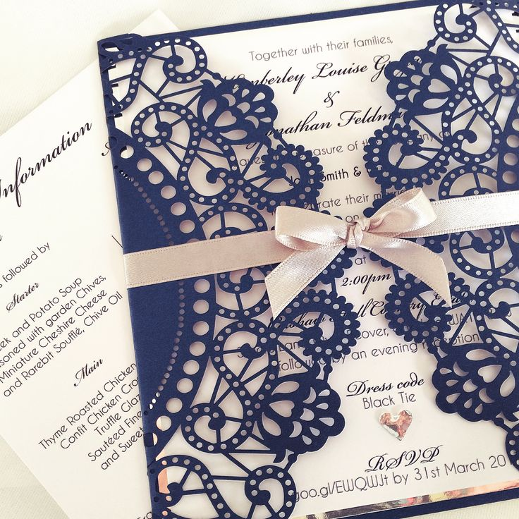 wedding invitation tied with ribbon%0A Navy laser cut invitation and stationery printed in script on white with  silver card and tied