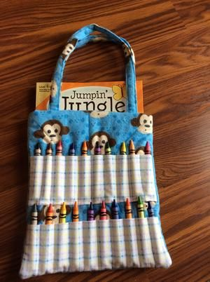 Children's Craft Bags from Sassy Accessories. It is a fully lined hand-sewn craft bag containing a coloring book and Crayola Crayons. #scottsmarketplace