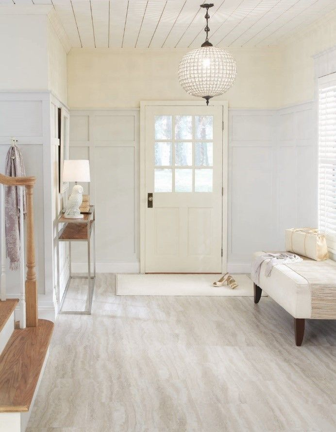 The floor makes an impressive entry in both homes and both are easy care luxury vinyl tiles from Tarkett. Trending With Traci | A Tale of Two Tones
