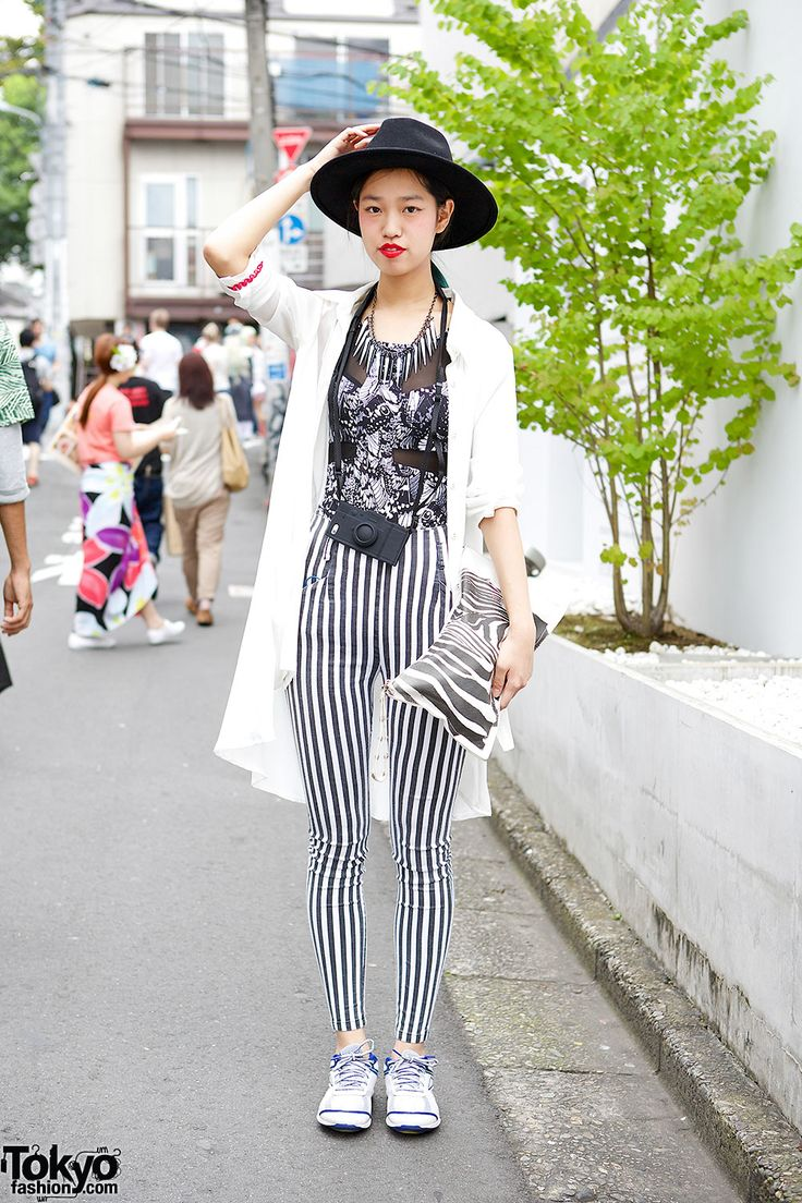 This is L, a stylish 19-year-old with blue hair, she's wearing a black & white outfit with hat & red lipstick, while her striped pants are by the Japanese brand Emoda. #vanitytours