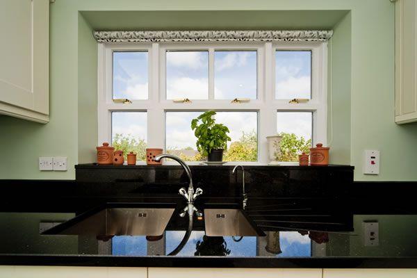 Black Galaxy Granite worktops, upstand and windowsill. Basil!
