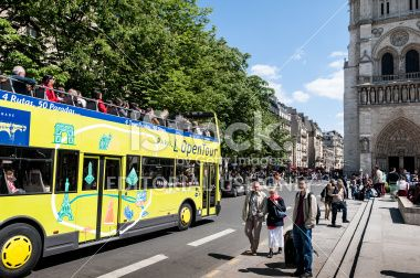 Bus tour next to Notre Dame church in Paris Royalty Free Stock Photo