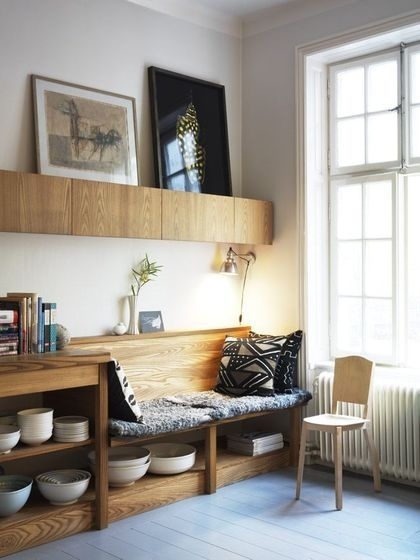 love this built in seating area.  It would be easy for a joiner to create a fold away table top hinged onto the back support of the bench.