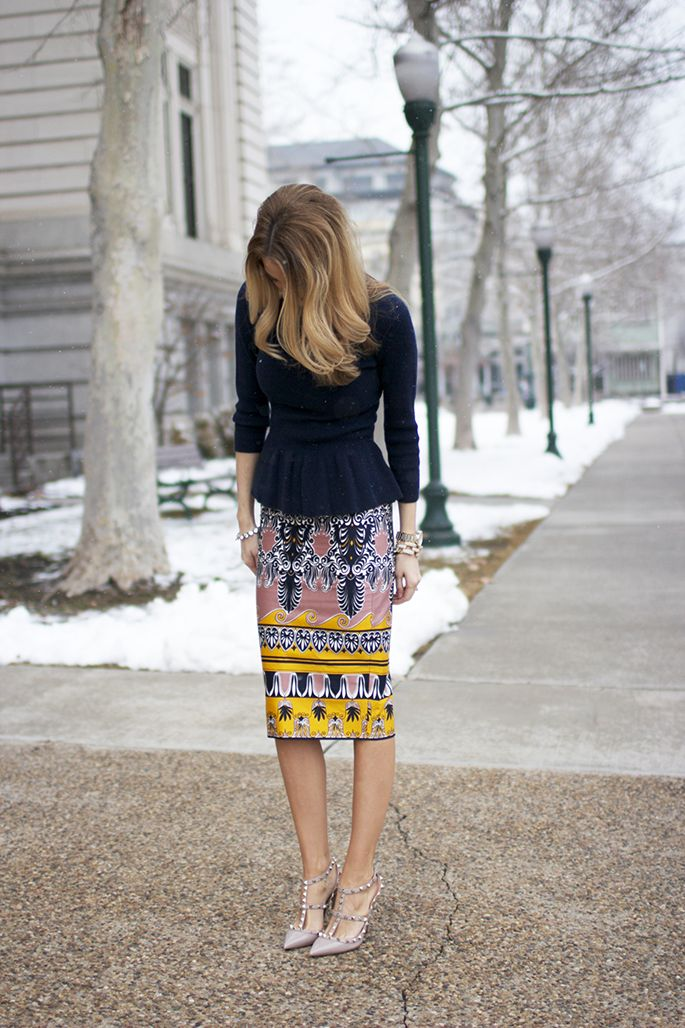 A print skirt and peplum top with pumps are great choices for a woman working in a creative field. More ways to build a creative career #wardrobe: http://www.franticbutfabulous.com/2013/11/22/capsule-wardrobe-creative-career-clothes/
