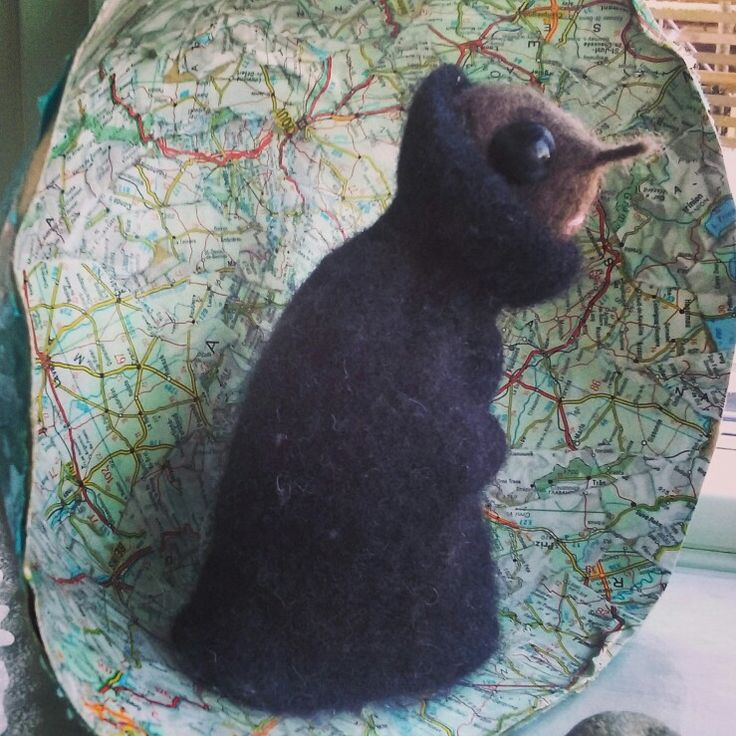 """""""The lonely one"""". Felted figure, recycled  sweater and ball of yarn. Stands in papier-marche bold made of maps. Already -used are the best materials!"""