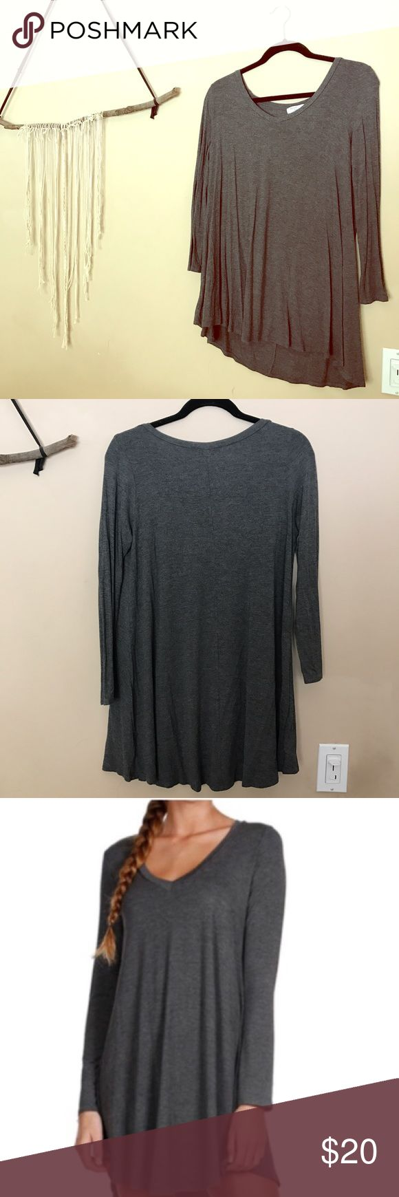 Grey long sleeve casual t shirt dress Reposhing, worn and washed once. Super cute, just never wear it! Perfect condition, make me a reasonable offer!                              • • • 30% off of bundles of 3+, free gifts (vintage, new, or handcrafted) with every purchase, and negotiable prices on every sale. • • • posh boutique Dresses Long Sleeve