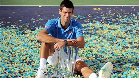 Novak Djokovic defeated Federer 6-3, 6-7 (5), 6-2 to win his fourth BNP Paribas Open on Sunday, tying him with Federer for the most titles in the desert after winning for the second straight year.