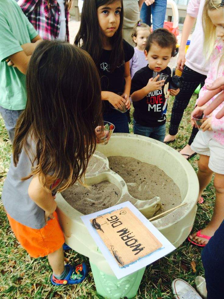Gone fishing party game. Worm dig. Whoever finds the most worms in the dirt wins a prize