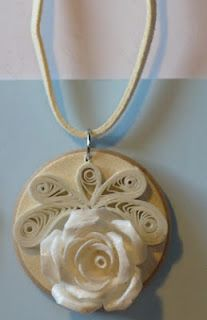 I could probably do some quilling and attach to scrabble tile. Seal it and cover in resin to make a pretty pendant.