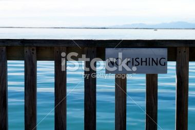 'No Fishing' Sign on Pier Royalty Free Stock Photo