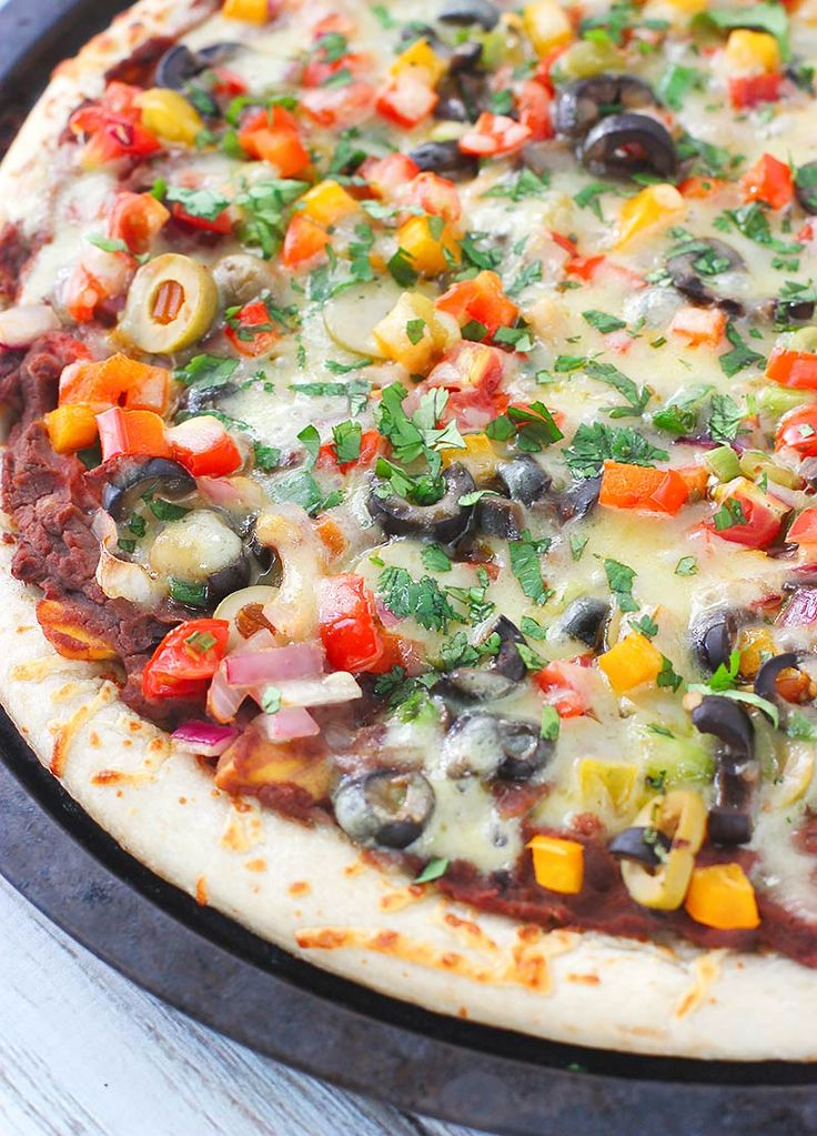 Vegetarian Mexican Pizza from SoupAddict.com - a veggie loaded pizza with a tasty black bean salsa sauce, cheese, and herbs.