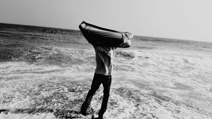 #adult #beach #black and white #leisure #man #ocean #outdoors #people #person #recreation #relaxation #sand #sea #seashore #sky #summer #surf #travel #vacation #water #waves #woman