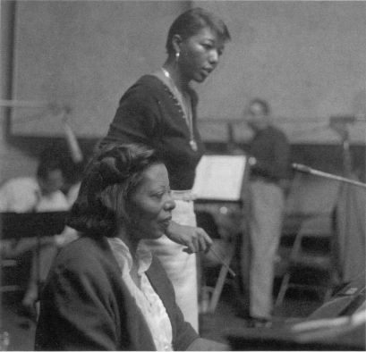 Pianist Mary Lou Williams with arranger- trombonist Melba Liston during a recording session for Roulette Records.