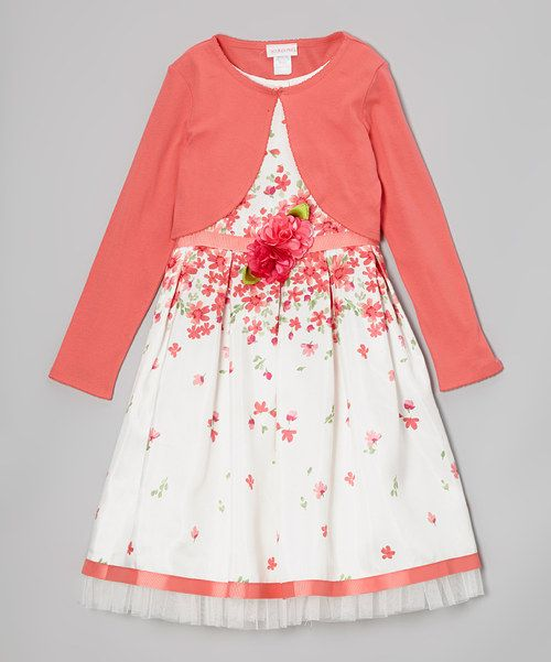 Any little lady will look and feel as fresh as a flower in this delightful ensemble thanks to its soft shrug and full skirt. Buttons at the back of the dress allow for quick and easy changes.