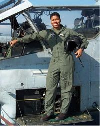 Six decades after our Tuskegee sisters broke the barrier in the military, former Marine Captain Vernice Armour  became the first female African American combat pilot in 2003.  Yes she did.  Yes we can.