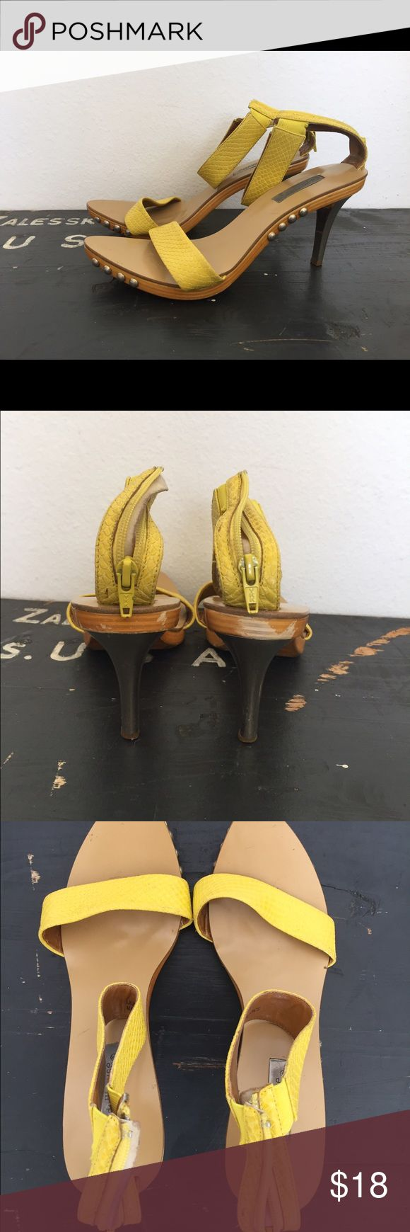 Yellow strappy heeled sandals from Dollhouse She is s beauty! Yellow straps sandals with debossed snakeprint on leather. Zip up closure, wooden outsole. 3.5 in metal heel. She is s stunner and perfect for nights out and parties. Dollhouse Shoes Heels