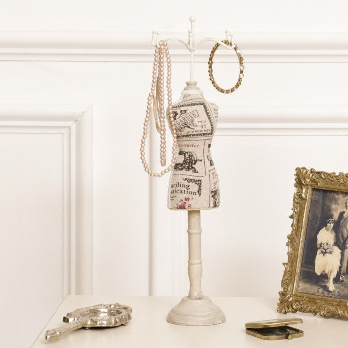 A Parisian themed jewellery stand complete with six hooks to the top, for safely hanging necklaces and bracelets. A good sized item that is suitable for hanging long or short pieces of jewellery, decorated with a Parisian print to the bodice, complete with a wooden standing frame decorated in distressed beige, suitable for all surface types complete with decorative lace attachment to the outline of the bodice. A vintage themed gift idea for any ladies dressing table!