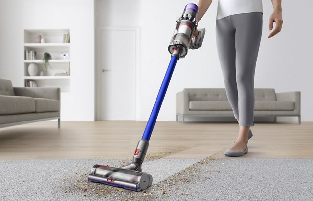 Woman Vacuuming Floor Using The Dyson Cyclone V10 Vacuum Cleaner