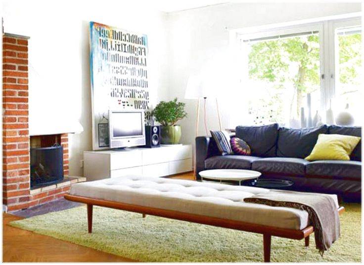 IN HOME PERSONAL SATISFACTORY SOLUTION BOX TO THE LIVING ROOM WITH A SOFA IN GREEN AND GRAY WITH A WHITE CARPET