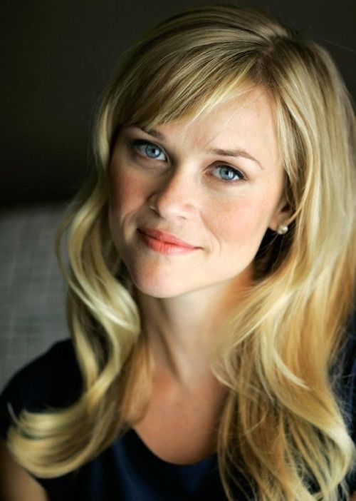 The unofficial heart-shaped face ambassador, Reese Witherspoon, shows off yet another stunning hairstyle. Here she sports long, wavy hair with short angular bangs. Angular bangs work well to create the illusion of a longer face, and they give your haircut a modern edge.
